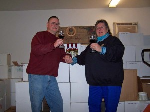 Steve and Marilyn in the winery tasting wine.