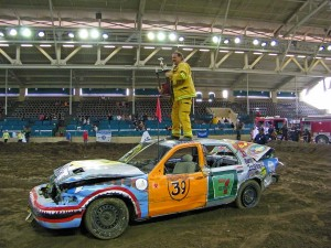 Son Ehren, a firefighter, receiving the trophy on for winning the Burn Institute Demolition Derby in a car sponsored by Woof'n Rose Winery at the San Diego County Fair.