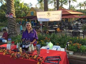 Marilyn pouring wine tastes at the San Diego Zoo charity event.